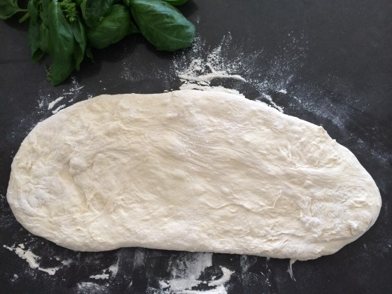 Forming the focaccia bread on the table